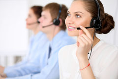Call center operators. Young beautiful business woman in headset. Call center. Male call operator in headset at the Royalty Free Stock Image