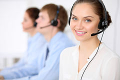 Call center operators. Young beautiful business woman in headset. Call center. Male call operator in headset at the Stock Images