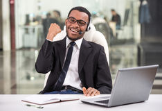 Call center. Portrait of happy man, call center representative is wearing headset royalty free stock images
