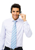 Call Center Representative Talking On Headset. Portrait of well-dressed call center representative talking on headset over white background. Vertical shot Stock Photography