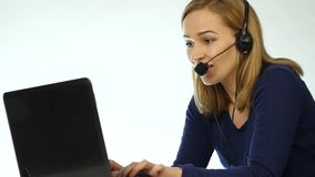 Call center representative talking on helpline, Headset telemarketing positive female call center agent at work. slow stock video footage