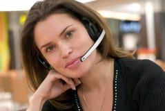 Call center secretary. Secretary in call center answering with handsfree Stock Photos