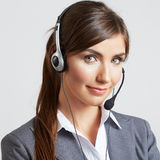 Call center smiling operator with phone headset Royalty Free Stock Photos
