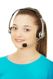 Call center smiling woman operator. Stock Photos