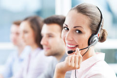 Call center team. Beautiful call center women smiling stock photos