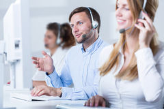 Call center team. Young call center team talking with customers Stock Photography