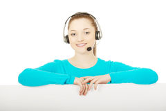 Call center woman with billboard. Royalty Free Stock Image