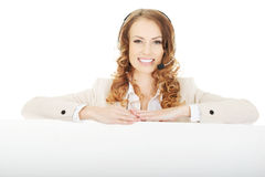 Call center woman with empty banner. Royalty Free Stock Photos