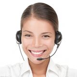 Call Center Woman with headset. Headset woman from call center. Portrait close-up of young smiling woman from call center wearing headset. Isolated on white Stock Image