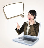 Call center woman with headset showing thumbs up with laptop. Isolated on white background stock photography