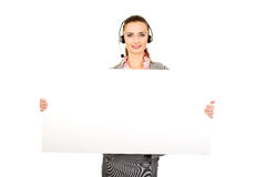 Call center woman holding empty banner. Stock Photo