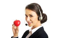 Call center woman holding heart model Stock Photos