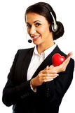 Call center woman holding heart model Stock Photography