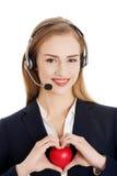Call center woman holding heart Royalty Free Stock Photos
