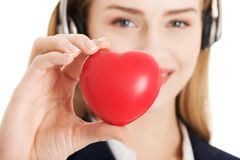 Call center woman holding heart Stock Image