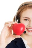 Call center woman holding heart Stock Images