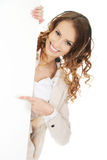 Call center woman pointing on empty banner. Royalty Free Stock Image