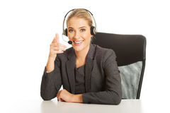Call center woman sitting at the desk Stock Photos