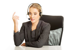 Call center woman sitting at the desk Royalty Free Stock Photography
