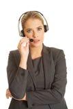 Call center woman talking to customer Stock Photos