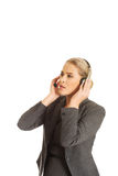 Call center woman talking to customer Royalty Free Stock Photography
