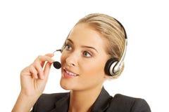 Call center woman talking to customer Stock Photo
