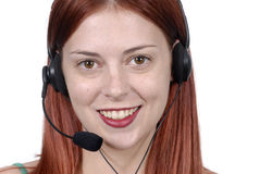 Young adult female call center woman telephone headset, smiling, looking at camera, close up Stock Photography