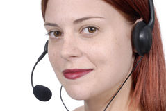 Call center female woman telephone headset, eyes looking at camera, white background, close up Royalty Free Stock Photos