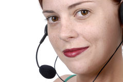 Close up young adult call center woman customer service telephone headset, white background Stock Image