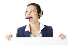 Call center worker holding blank board Royalty Free Stock Photos