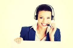 Call center worker holding blank sign board Stock Photos