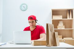 The call center worker at parcel distribution center in post office. Call center worker at parcel distribution center in post office royalty free stock photo