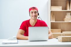 The call center worker at parcel distribution center in post office. Call center worker at parcel distribution center in post office stock image