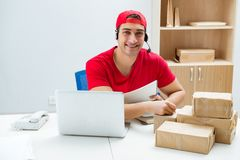 The call center worker at parcel distribution center in post office. Call center worker at parcel distribution center in post office stock photo