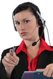 Call-center worker with pen Royalty Free Stock Photo