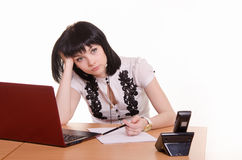 Call-center worker wondered front of monitor, leaned her head on Royalty Free Stock Photography
