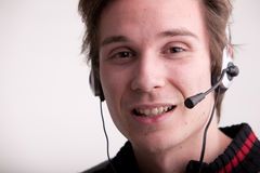 Call center young man with a headset Stock Photography