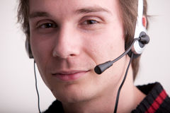 Call center young man with a headset Royalty Free Stock Photography