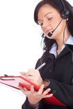 Call center young woman with a headset Stock Images