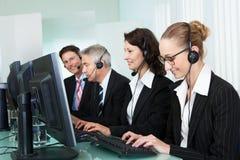 Call centeroperatörer Arkivfoto