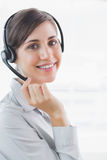 Call centre agent smiling at the camera Stock Photography