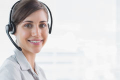 Call centre agent smiling at camera Royalty Free Stock Photography