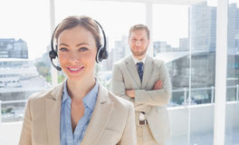 Call centre agent standing with colleague behind her Stock Photography