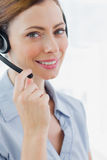 Call centre agent wearing headset smiling at camera Royalty Free Stock Images