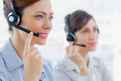 Call centre agents at work. And smiling Stock Photo