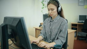 Call centre agents working in their bright office stock footage