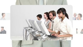 Call centre agents working together in their offices Stock Image