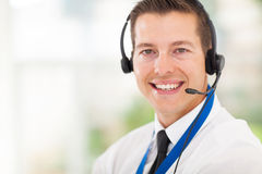 Call centre employee. Successful male call centre employee wearing a headset Stock Photos