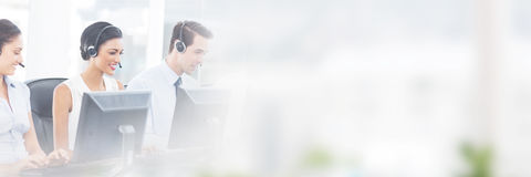 Call centre employees smiling while sitting. St office Royalty Free Stock Images