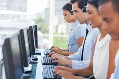 Call centre employees working on computers Stock Photography